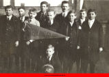 Boys posing with pennant