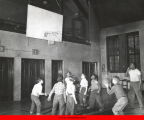 Children playing a game of basketball at Marcy Center's gymnasium