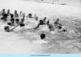 Children swimming in old swimming pool