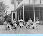 Women knitting outside farmhouse at Bowen Country Club