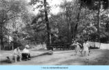 Young woman playing horseshoes