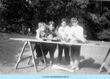 Boys standing at sawhorse table
