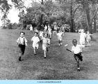Children run down the hill at Bowen Country Club