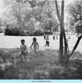 Children walking across field