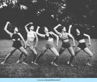 Five young women dancing