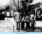 Man and children waking in the snow