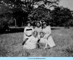 Five girls pose on lawn