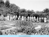 Mothers and children in garden at Bowen Country Club
