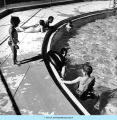 Children at edge of swimming pool