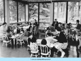 Children eating on porch of Rosenwald Cottage
