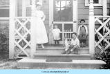 Nurse and children on hospital porch