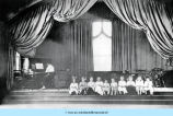 Girls seated on stage
