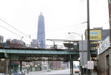 Elevated train tracks and Hancock Center under construction