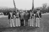 Alderman Tony Laurino and Congressman Frank Annunzio with men in historical military costumes
