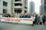 Joint Civic Committee of Italian Americans banner held by marchers in Columbus Day Parade