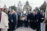 "A group of men laying a ""Sons of Italy"" wreath in Arrigo Park"