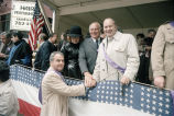 Congressman Frank Annunzio shaking a man's hand at the Columbus Day Parade