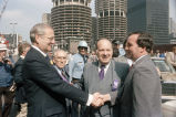 Lee Iacoca, Congressman Frank Annunzio, and Mayor Richard M. Daley