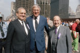 Lee Iacocca, Curt Prinz, and Congressman Frank Annunzio in front of Marina Towers
