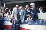 Congressman Frank Annunzio with others on the reviewing stand of the Columbus Day Parade