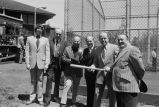 Congressman Frank Annunzio, Ed Kelly (with bat) at the opening of baseball season in Hamlin Park