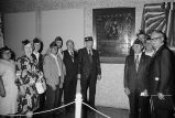 Annunzio with veterans in front of plaque in Dirsken Federal Building