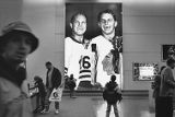 Fans Looking at Portrait of Hockey Players