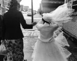 Wind Blowing Veil of Girl in First Communion Dress