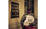 Man Selling Newspaper Outside Bank