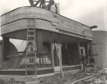 [Construction of a giant toy wagon in preparation for the Enchanted Island exhibit at A Century of...