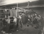 [Workers assemble the electrical wiring to power the Century of Progress Hall of Science building. This