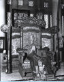 [Photo of a Tibetan Buddhist throne inside the Lama Temple exhibit at A Century of Progress. This...