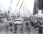 [A Walgreen's float parading down the Avenue of Flags at A Century of Progress International Exhibition.]