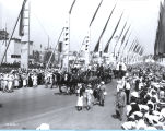 [Horse-drawn wagons parading down the Avenue of Flags at A Century of Progress International...
