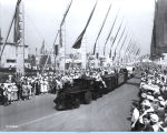 [A model Illinois Central train parading down the Avenue of Flags at A Century of Progress International