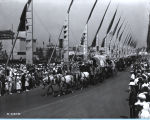 [Conestoga wagons parading down the Avenue of Flags at A Century of Progress International Exhibition.]