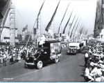 [The white owl truck parading down the Avenue of Flags at A Century of Progress International Exhibition.]