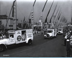 [Heinz ketchup trucks parading down the Avenue of Flags at A Century of Progress International...