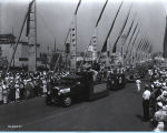 [The General Motors float parading down the Avenue of Flags at A Century of Progress International Exhibition.]