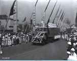 [The Cuneo Press float parading down the Avenue of Flags at A Century of Progress International...