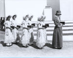 [A procession of women in period costume carrying what appear to be bibles at the Century of Progress