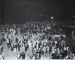 [Night photograph of pedestrian traffic at A Century of Progress International Exposition.]