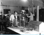 [Technicians construct a model petroleum refinery for exhibition at A Century of Progress. The...