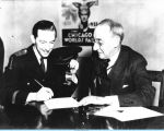 Century of Progress President Rufus C. Dawes signing papers with famed jazz musician Hal Kemp.
