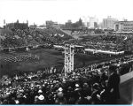 [A Crowd gathers in May of 1933 to watch parades and marching bands perform at Soldier Field.]