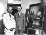 [Century of Progress Rufus C. Dawes (left), and RCA executive Owen D. Young standing in front of a painting
