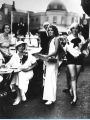 [Aimee Semple McPherson (seated on the left) at the Streets of Paris outdoor café. McPherson was a...