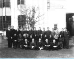 [Employees from the Century of Progress Mailing Room pose for a group photograph. The photo is...