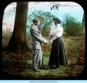 [Unidentified painting of a couple standing in a park.]