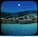[Photo of a small town with a Grand View Hotel located along the waterfront at an unknown location.]
